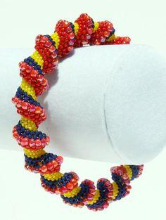 Orange Cellini Spiral Bangle Bracelet
