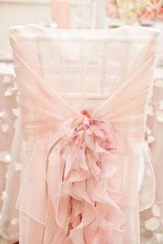 Blush chair covers for a romantic blush wedding.