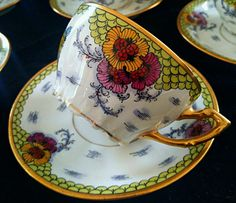 FABULOUS VIGNAUD LIMOGES LARGE 15 PIECE TEA/COFFEE SERVING SET.. WITH STUNNING PURPLE & YELLOW FLORALS AND BIRD PATTERN WITH SOME BUTTERFLYS AND BUGS This is a beautiful TEA OR COFFEE SET. It inclu