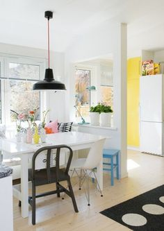Lovely kitchen and dining room with black white yellow and turquoise