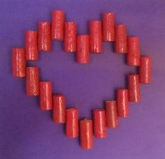 Wine corks spraypainted and turned into a heart.