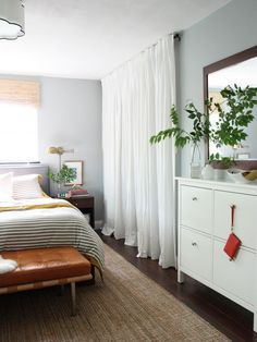 Got ugly closet doors you want to hide? Try this drapery trick - Personally, I think it would look better if the window had the same treatment...