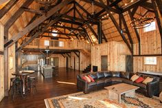 WOW! Gorgeous barn home with an open floor plan! The dark beams really stand out!  Sand Creek Post & Beam