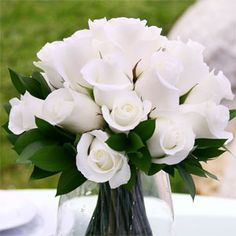 Elegant and classy... beautiful wedding centerpiece with white roses