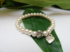 A personal favorite from my Etsy shop https://www.etsy.com/listing/255251089/flower-girl-stretchy-pearl-bracelets
