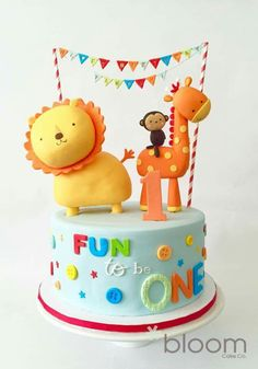 Fun to be one. Cute birthday cake with bunting, lion, giraffe and monkey