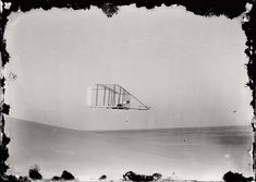 """October 10, 1902. Kitty Hawk, N.C. (Actually Kill Devil Hills) """"Wilbur gliding in level flight, moving to right near bottom of Big Hill."""" Glass negative by Orville Wright."""