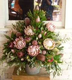 Gorgeous wow factor arrangements of wild flowers, featuring King Protea Menzii Banksia, Little Prince Protea, Pink Ice Protea