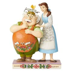 Belle's father Maurice models one of his latest inventions in this affectionate figurine inspired by Disney's Beauty and the Beast. Handcrafted and hand-painted in exquisite detail, this stone resin figure by Jim Shore makes a beautiful keepsake.