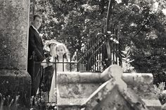 Wedding Photography Dorset - bridesmaid looking out for the arrival of the bride Linus Moran Photography Prospect House Peverell Ave East Dorchester 01305 755663