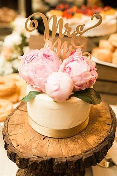 Featured Photographer: Garrett Richardson; Romantic white wedding cake topped with pink peonies