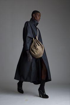 Vintage Issey Miyake Coated Trench, Fendi Drawstring Bag and Leather Moto Gloves. Designer Clothing Dark Minimal Street Style Fashion