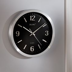 The Live Video Feed Surveillance Clock. DescriptionLifetime Guarantee This is the wall clock with a built-in camera that discreetly records high-definition video and audio and streams the footage live to any computer or smartphone. Ideal for real-time, covert monitoring of a home or office when you're away, the clock's concealed motion-activated image sensor (located at the six o'clock position) captures full-color video at up to 720 x 480 resolution the instant it detects movement.