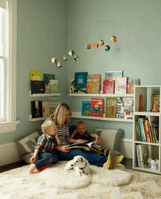 Reading corner with low shelves and floor pillows.
