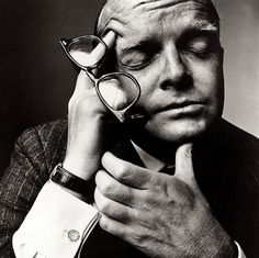 American writer Truman Capote holding his characteristic horn-rimmed glasses. Photo by Irving Penn taken in 1965. For more on the iconic objects that have shaped our lives, please visit www.klokers.com.