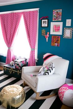Fun, colorful nursery in teal, pink, black, and gold.