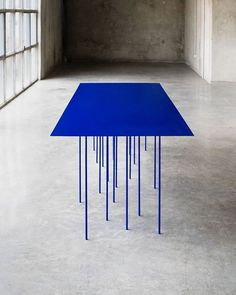 Reminding me of rain, the multi legged bright blue table