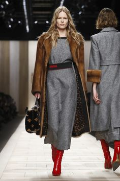 Showcasing technical skill and Italian heritage, Silvia Venturini Fendi and Karl Lagerfeld concentrated on layered pieces that were a direct reference to Roman architecture. Conservative plaid look...