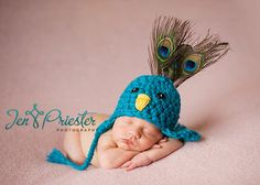 Pretty Little Peacock Earflap Hat. $40.00, via Etsy. This is HILARIOUS.  Don't know for whom, but I want to make one!
