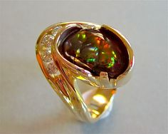"""I will probably continue with fire agate. But going is always slow for I am a one person operation and do everything from the stone acquisition, to the designing, to all the goldsmith work and stone setting. This piece sells for $4500. Lay a ways always available and all credit cards accepted. Please add 9.25% sales tax for any sales and delivery within California. No sales tax is mailed out of Ca. Thanks again and for those who haven't already, please """"LIKE"""" Glenn Dizon Designs."""