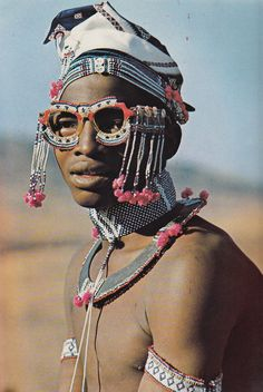 Can I get these glasses? via the Looksee  African Elegance by Alice Mertens / photos by Joan Broster (1973)