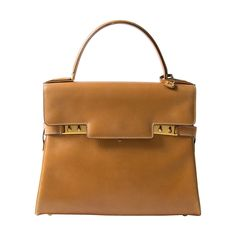 Delvaux Cognac Tempête | From a collection of rare vintage handbags and purses at https://www.1stdibs.com/fashion/handbags-purses-bags/