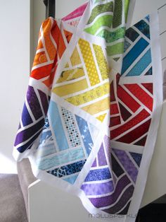 Rainbow Herringbone Quilt by Molli Sparkles - Also has link to tutorial for this block pattern
