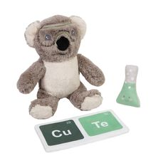 Sam Koalified (the koala bear) is a super soft hard-working scientist who brings a CU-TE periodic table filled with crinkle paper and a rattle shaped like a test beaker. Sam commutes from 300 Eucalyptus Trail in the Eucalyptus Forest in Australia. Sam is designed to nurture sensory development and hand-eye coordination as a STEM early learning toy and provides comfort and companionship as well as satisfying tactile and sound play. Sam is methodical, inquisitive, and analytical a leaf-eating spec Learning Toys, Early Learning, Baby Gift Sets, Baby Gifts, Apa Paper Example, Unisex Baby, Cuddling, Little Ones, Plush