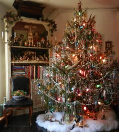 Old-fashioned tree, village beneath, nativity and Christmas pyramid on the shelf. Ahhhh.