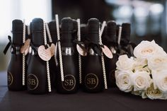Fun wedding favor idea - mini champagne bottles with straws! {Vitaly M Photography}