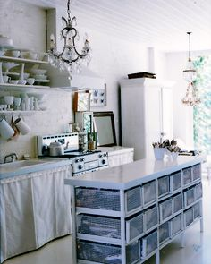 Love this industrial kitchen by the sea