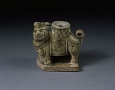 Candlestick in the form of a lion, glazed stoneware, Yaozhou ware, China, Jin dynasty (1115-1234).