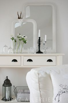 Console with mirrors and anemones