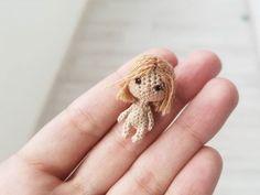 Лялечка  Не знаю сколько в сантиметрах, думаю, 2.5  Пойду ей платье вязать))) #ami_dolls #ami_dolls_evolution #tinycrocheting #tinydoll #tinyamigurumi #miniature #artdoll