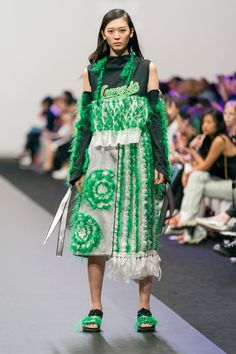 Reconstructed and up-cycled hoodie, with embellished detachable sleeves and green and white midi skirt made from secondhand clothing and damaged textiles. Design by Sung Yi Hsuan  #ECDA #SungYiHsuan #sustainablefashion #upcycle #reconstruction