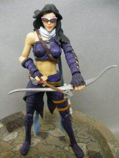 this is a marvel legends Hawkeye (Kate Bishop) Custom Action Figure she was made by figure realmer tommyx he used the 2-pack Elektra body, bow arrow and quiver marvel universe dark hawkeye, x-treme rogue glasses, white queen cape bits for the scarf, and daredevil nunchucks happy pinning