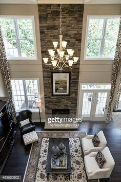 Amazing two story great room layout - fllor to ceiling stone fireplace, lots of natural light & french doors. I would add another set of french doors with transom windows for symmetry!
