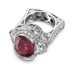 "Molina platinum ""Temple of the Sacred Heart"" ring, 10.05 ct. oval untreated ruby with white diamonds and rubies. Platinum Honors winner at AGTA Spectrum Awards"