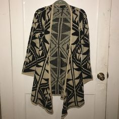 Long Aztec design cardigan Super soft and trendy long cardigan. Hardly worn. Aztec design. Size small but fits like a medium. Willing to negotiate price  Urban Outfitters Sweaters Cardigans