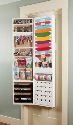 "an over-the-door organizational armoire for scrapbooking products on HSN this coming May!  -It will come pre-assembled  -is 35 pounds  -5' long, 6-1/2"" wide  -Has cork on the front   -Can also be hung on the wall  -Each paper slot holds 30 sheets of paper  -Inner drawers are removable so you could take them out and bring them to your workspace  -Price point is $250."