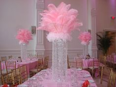 """Rent Crystal Columns.Includes 30"""" crystal column, LED lighting, set up and take down. Available upgrades include feather top as shown or Fresh Flower Ring.  Ask for a free price quote and our 34 page color brochure. Call (631) 421-2286 Email cherrise@sweet16candelabras.com or watch our 100 videos on YouTube at www.youtube.com/sweet16candelabras  Visit our website at www.sweet16candelabras.com"""