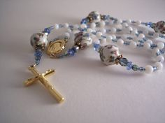 beautiful handmade porcelain rosary with genuine mother of pearl, Czech crystal and gold. $48.00, via Etsy.