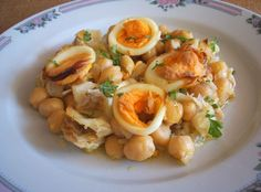 Cod with chickpeas in the oven - Food From Portugal. Delicious recipe of cod with chickpeas seasoned with pepper, wrapped in a saute of olive oil, onion and garlics, that goes in the oven garnished with slices of boiled egg and sprinkled with chopped parsley. http://www.foodfromportugal.com/cod-with-chickpeas-in-the-oven/