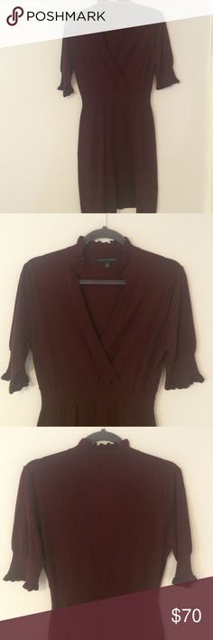 Lovely Sweater Dress Wine coloured sweater dress! V-neck with higher ruffle collar and short sleeves with elastic and ruffle detail: stretch at waist. Tiny hole at back, barely noticeable when on! Worn a few times, great condition! Bundle and save 25%! Banana Republic Dresses