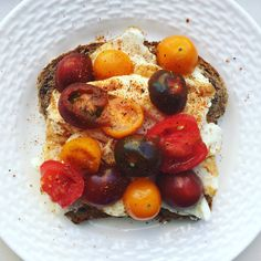 This is 3 egg whites on Eli's #health-bread topped with an #oliveoil drizzle, a sprinkle of blackened spice and #tomatoes.