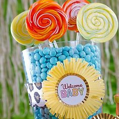 Sweet baby shower candy buffet idea! Baking cups + paper cut-outs make the BEST custom labels! Click through for the how-to.