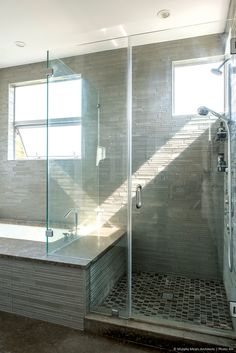 The master tub deck transforms into a bench seat for the shower.