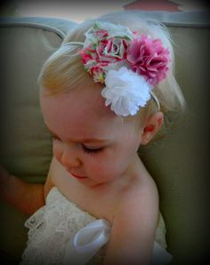 Purple and white satin/mesh flowers with a multicolored shabby flower headband. Great price and low shipping!