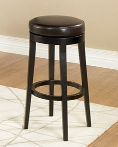 Dark brown leather, 26-inch high, 360 degree swivel backless barstool. Fully padded seat with espresso wood finish legs. #Armen Living is the quintessential mode...