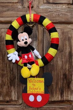 This item is made out of felt, cardboard paper, and a Mickey Mouse doll. This was inspired for a one year old Mickey Mouse party, as are the other Mickey Mouse Doll, Mickey Mouse Classroom, Mickey Mouse Crafts, Mickey Mouse Parties, Mickey Party, Disney Crafts, Disney Classroom, Mickey Mouse Wreath, Mickey Mouse Centerpiece